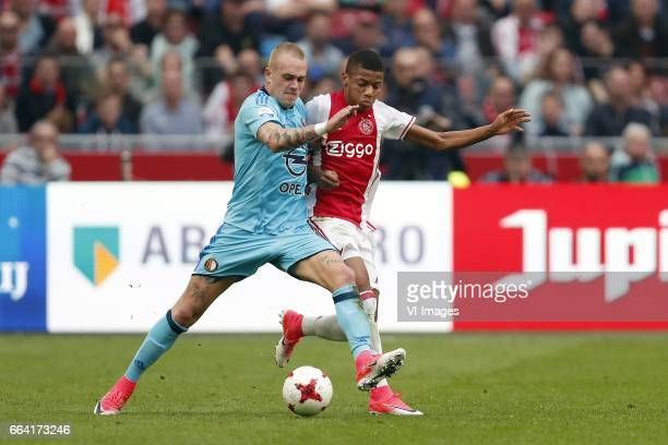 Rick Karsdorp of Feyenoord David Neres of Ajaxduring the Dutch Eredivisie match between Ajax Amsterdam and Feyenoord Rotterdam at the Amsterdam Arena...