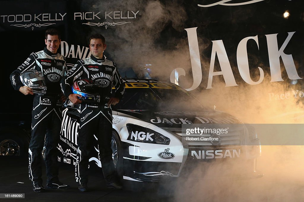 Rick Kelly and Todd Kelly pose with the Jack Daniel's Racing Nissan Altima during the Nissan 2013 V8 Supercar launch at the Melbourne Showgrounds on...