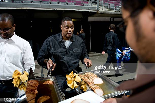 Rick Mahorn Detroit Pistons legend serves dinner during the Detroit Pistons Thanksgiving Feast for 700 Oakland County guests at the Palace of Auburn...