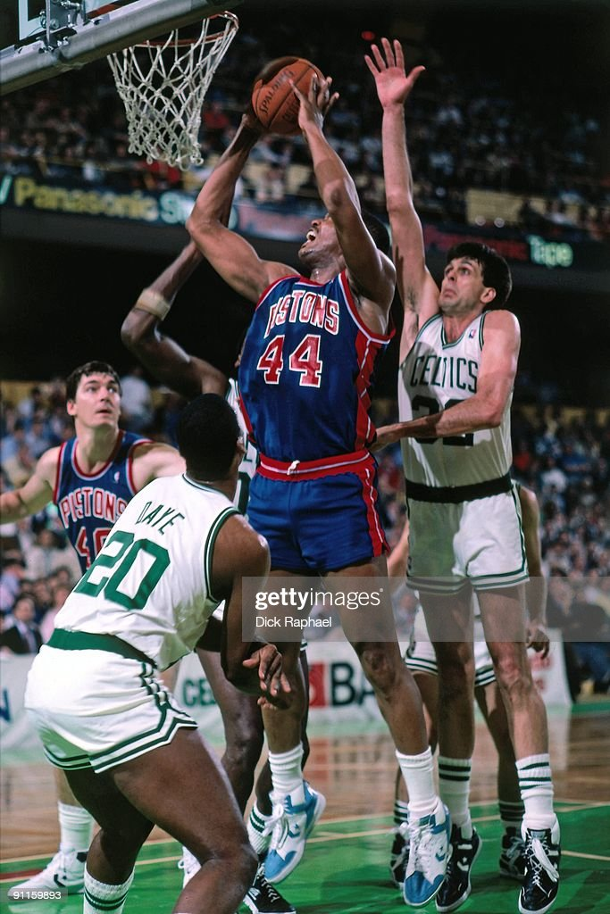 Rick Mahorn of the Detroit Pistons goes up for a shot against Kevin McHale of the Boston Celtics during a game played in 1987 at the Boston Garden in...