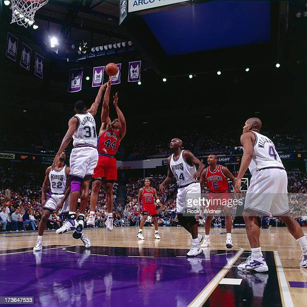 Rick Mahorn of the Detroit Pistons shoots against Duane Causwell of the Sacramento Kings during a preseason game played on October 17 1996 at Arco...