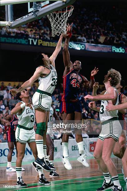 Rick Mahorn of the Detroit Pistons shoots the ball over Kevin McHale of the Boston Celtics during a game circa 1986 at the Boston Garden in Boston...