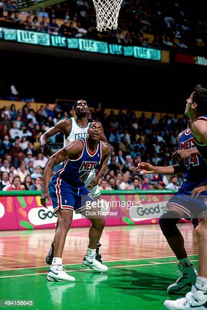 Rick Mahorn of the New Jersey Nets boxesout Robert Parish of the Boston Celtics during a game played at the Boston Garden in Boston Massachusetts...