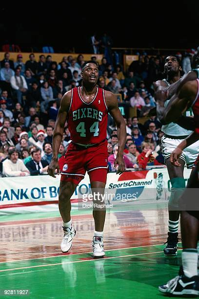 Rick Mahorn of the Philadelphia 76ers looks on against the Boston Celtics during a game played in 1989 at the Boston Garden in Boston Massachusetts...