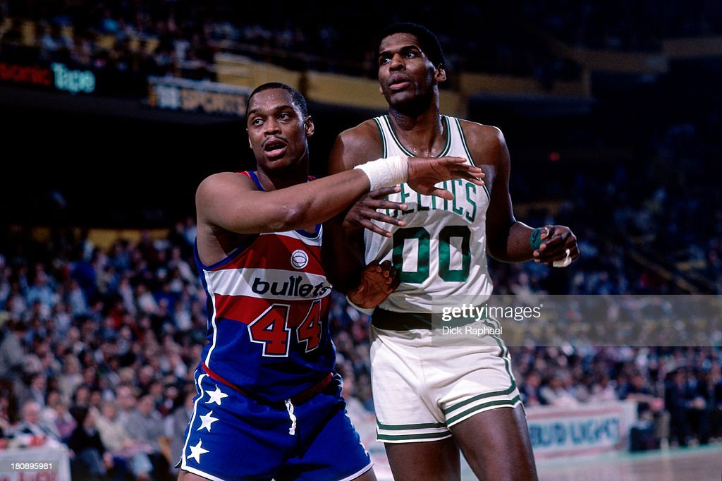 Rick Mahorn of the Washington Bullets defends Robert Parish of the Boston Celtics during a game circa 1985 at the Boston Garden in Boston...