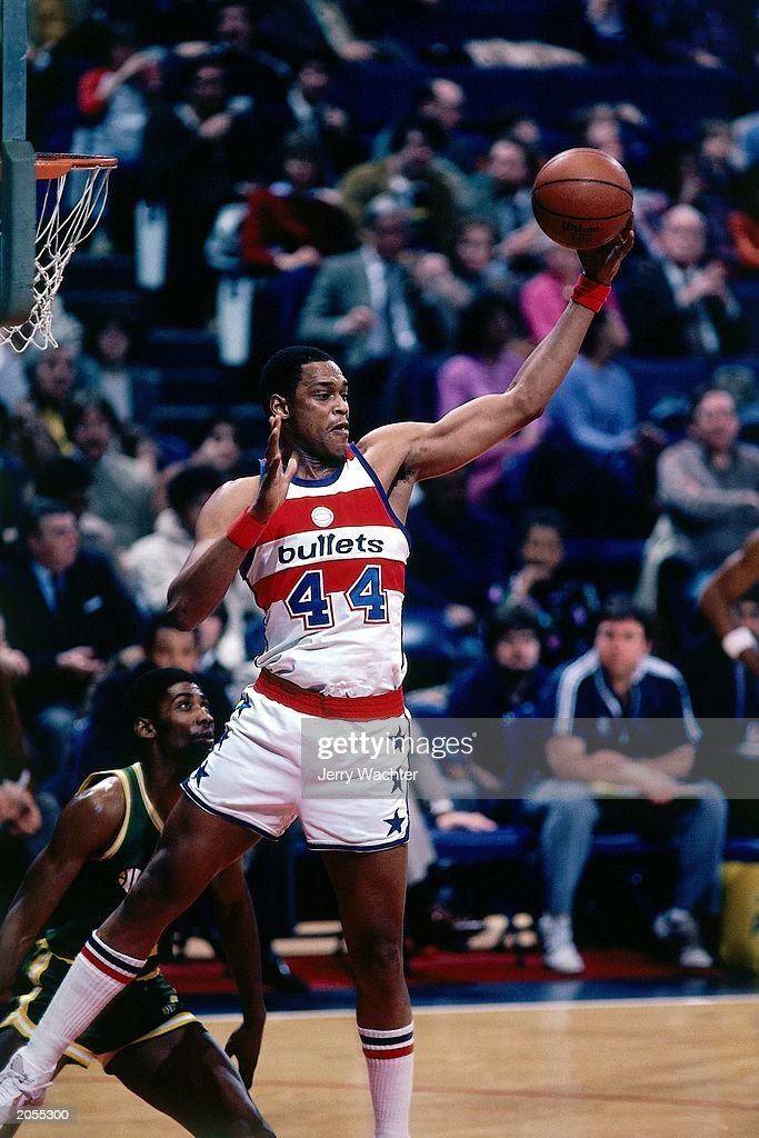 Rick Mahorn of the Washington Bullets grabs a rebound against the Seattle SuperSonics during the 1981 season NBA game at the USAir Arena in...