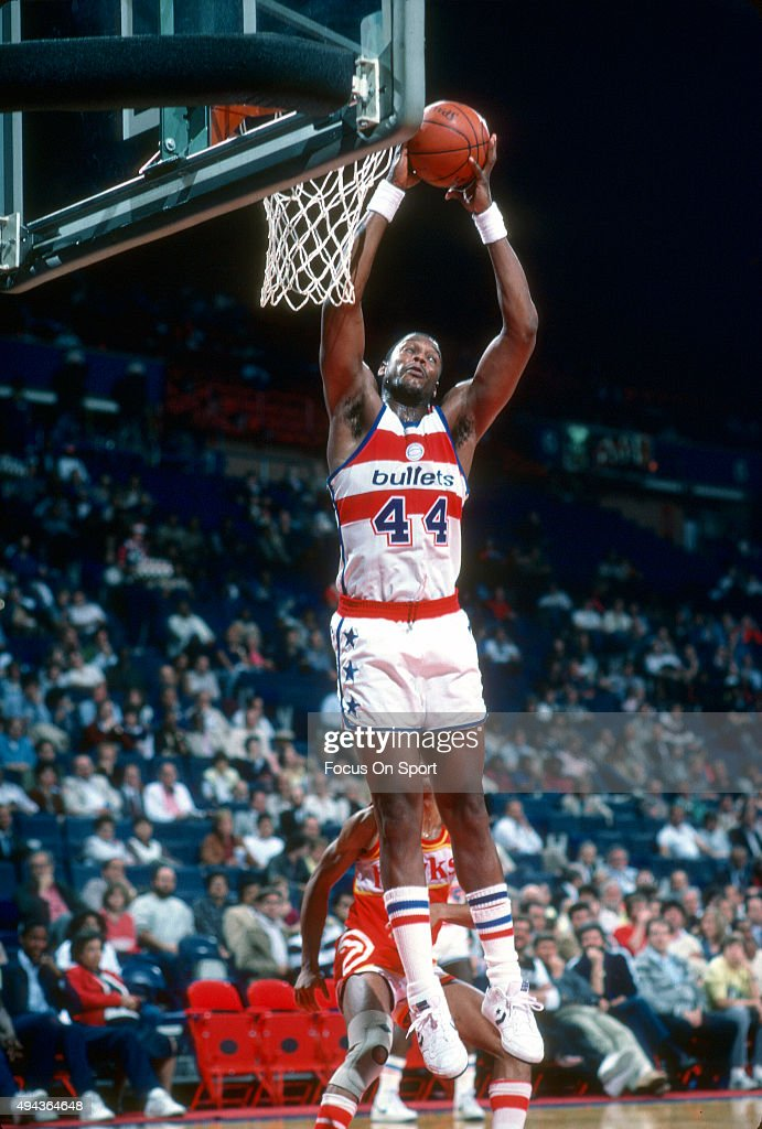 Rick Mahorn of the Washington Bullets grabs a rebound against the Atlanta Hawks during an NBA basketball game circa 1983 at the Capital Centre in...