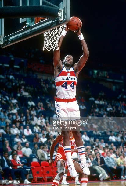 Rick Mahorn of the Washington Bullets grabs a rebound against the Atlanta Hawks during an NBA basketball game circa 1983 at the Capital Centre in...