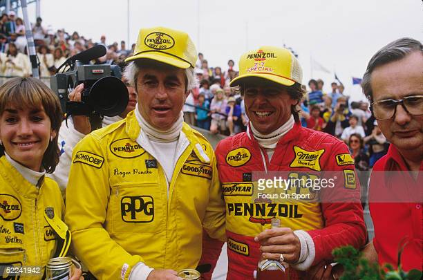 Rick Mears talks with Roger Penske after racing the Indy 500 at the Indianapolis Motor Speedway on May 27 1984 in Indianapolis Indiana Rick Mears won...