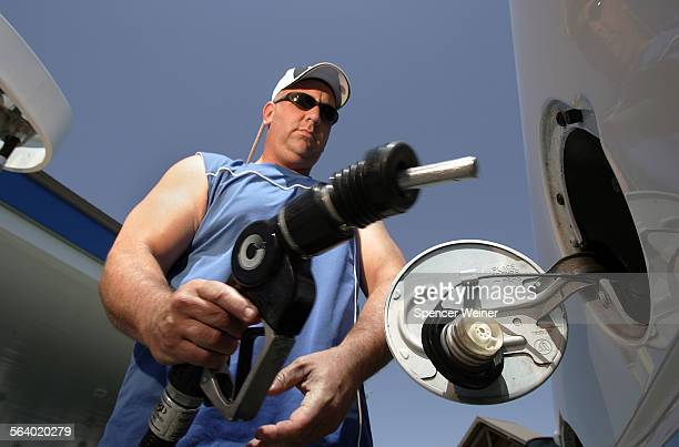 Rick Murray fills his tank at a gas station in Wheeler Ridge California along the I–5 Monday May 28 2007 Memorial Weekend vacationers are paying a...