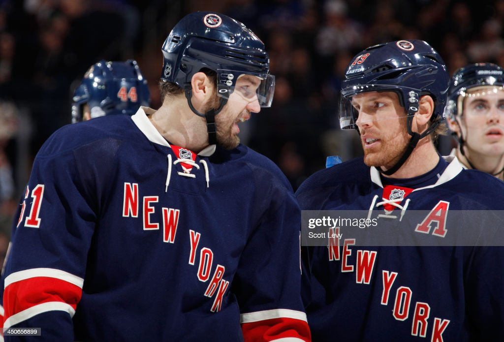 Rick Nash #61 and Brad Richards #19 of the New York Rangers talk during a break in the action against the Boston Bruins at Madison Square Garden on November 19, 2013 in New York City.
