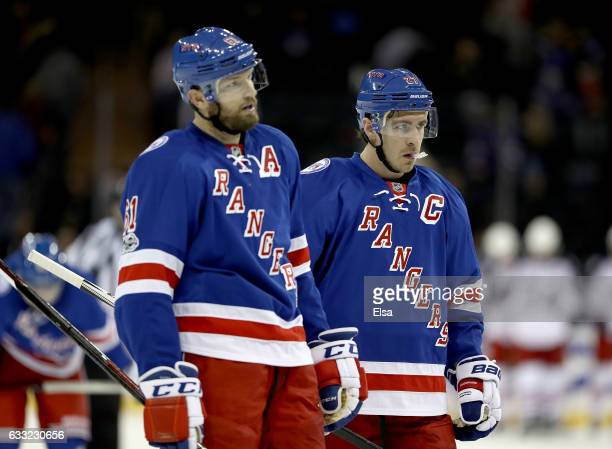 Rick Nash and Ryan McDonagh of the New York Rangers react to the loss to the Columbus Blue Jackets on January 31 2016 at Madison Square Garden in New...