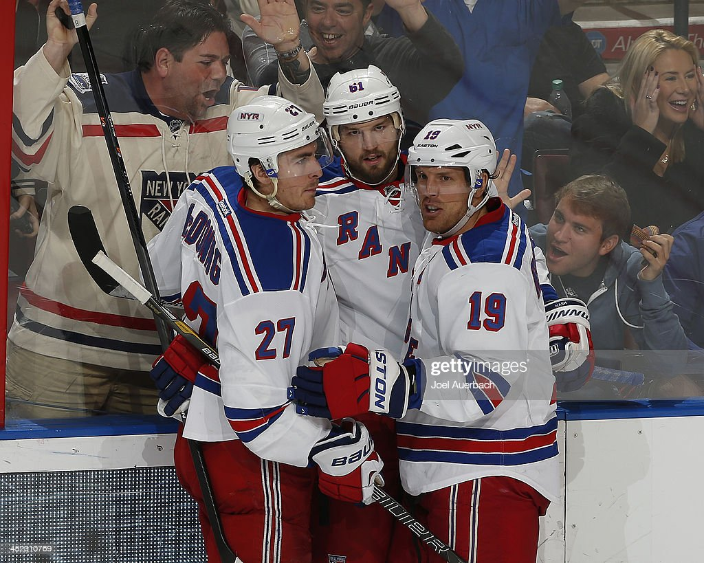 Rick Nash #61 is congratulated by <a gi-track='captionPersonalityLinkClicked' href=/galleries/search?phrase=Ryan+McDonagh&family=editorial&specificpeople=4324983 ng-click='$event.stopPropagation()'>Ryan McDonagh</a> #27 and <a gi-track='captionPersonalityLinkClicked' href=/galleries/search?phrase=Brad+Richards&family=editorial&specificpeople=202622 ng-click='$event.stopPropagation()'>Brad Richards</a> #19 of the New York Rangers after scoring a third period goal against the Florida Panthers at the BB&T Center on November 27, 2013 in Sunrise, Florida. The Rangers defeated the Panthers 5-2.