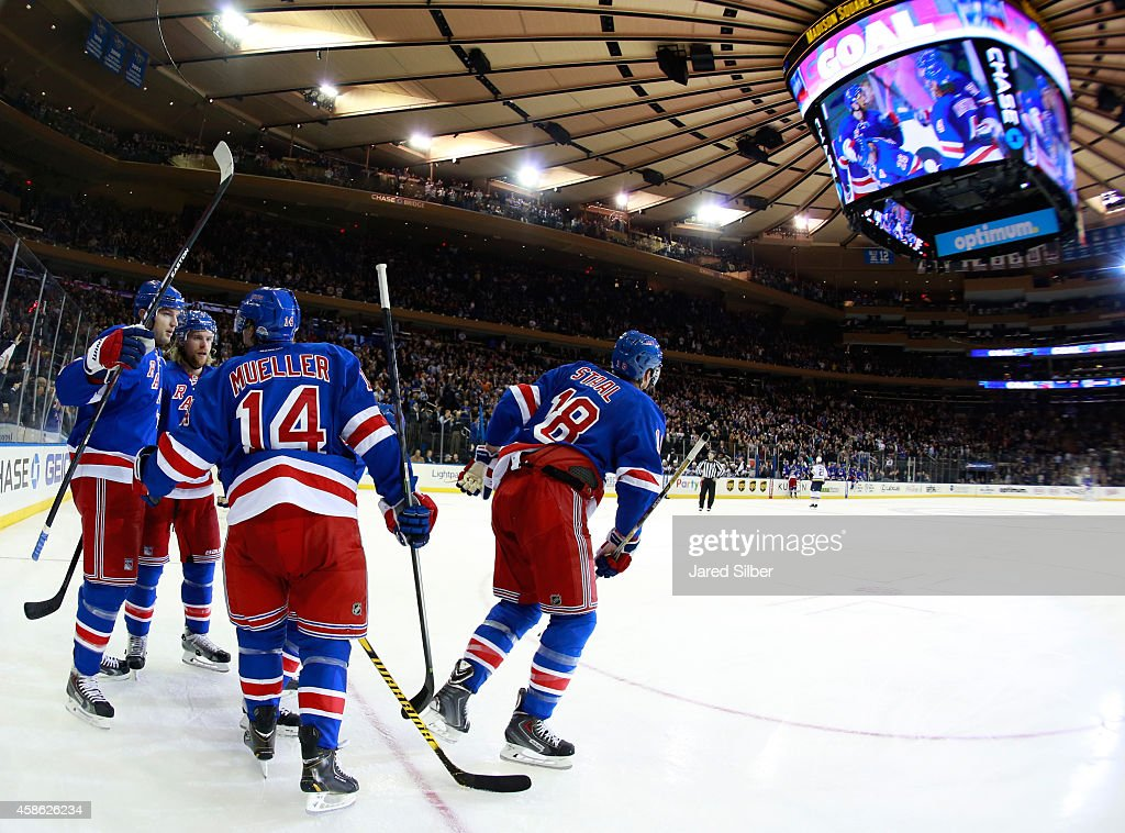 Rick Nash Mike Kostka Marc Staal and Chris Mueller of the New York Rangers celebrate after a third period goal against the St Louis Blues at Madison...