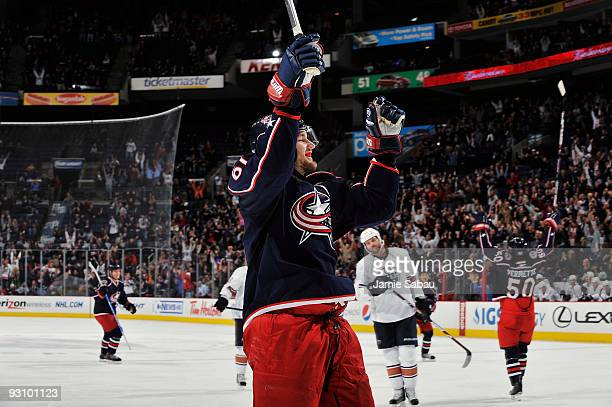 Rick Nash of the Columbus Blue Jackets celebrates after his teammate Antoine Vermette of the Columbus Blue Jackets scored the game tying goal during...
