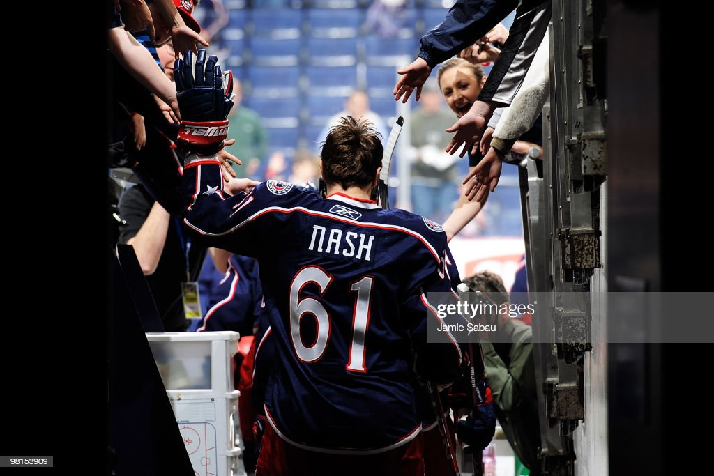 <a gi-track='captionPersonalityLinkClicked' href=/galleries/search?phrase=Rick+Nash&family=editorial&specificpeople=202196 ng-click='$event.stopPropagation()'>Rick Nash</a> #61 of the Columbus Blue Jackets high fives fans on his way out to the ice for the warm-up prior to the start of the game against the the Tampa Bay Lightning on March 30, 2010 at Nationwide Arena in Columbus, Ohio.