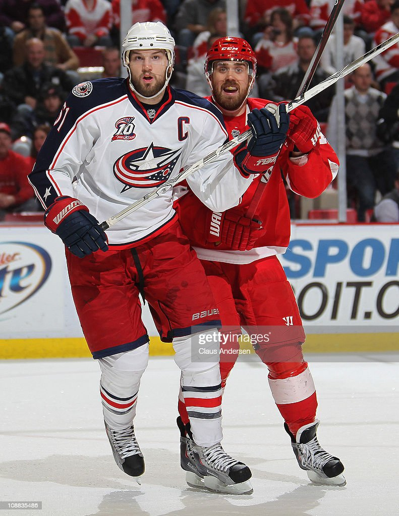<a gi-track='captionPersonalityLinkClicked' href=/galleries/search?phrase=Rick+Nash&family=editorial&specificpeople=202196 ng-click='$event.stopPropagation()'>Rick Nash</a> #61 of the Columbus Blue Jackets is held in check by <a gi-track='captionPersonalityLinkClicked' href=/galleries/search?phrase=Henrik+Zetterberg&family=editorial&specificpeople=201520 ng-click='$event.stopPropagation()'>Henrik Zetterberg</a> #40 of the Detroit Red Wings in a game on February 4, 2011 at the Joe Louis Arena in Detroit, Michigan. The Blue Jackets defeated the Wings 3-0.