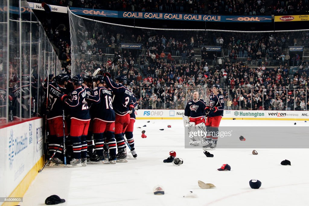 Rick Nash of the Columbus Blue Jackets is swarmed by his teammates after scoring his third goal to give him a hat trick and defeat the Detroit Red...