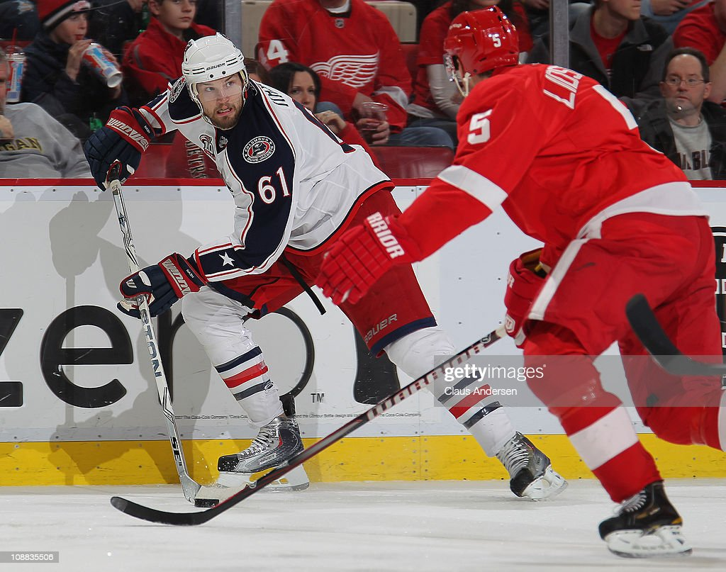 <a gi-track='captionPersonalityLinkClicked' href=/galleries/search?phrase=Rick+Nash&family=editorial&specificpeople=202196 ng-click='$event.stopPropagation()'>Rick Nash</a> #61 of the Columbus Blue Jackets skates away from the checking <a gi-track='captionPersonalityLinkClicked' href=/galleries/search?phrase=Nicklas+Lidstrom&family=editorial&specificpeople=201470 ng-click='$event.stopPropagation()'>Nicklas Lidstrom</a> #5 of the Detroit Red Wings in a game on February 4, 2011 at the Joe Louis Arena in Detroit, Michigan. The Blue Jackets defeated the Wings 3-0.