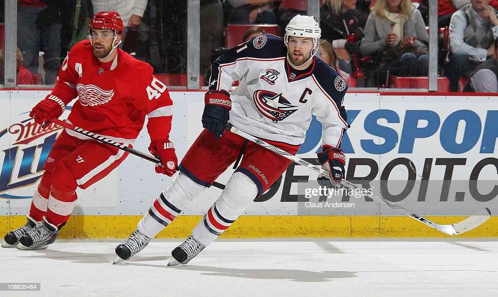 <a gi-track='captionPersonalityLinkClicked' href=/galleries/search?phrase=Rick+Nash&family=editorial&specificpeople=202196 ng-click='$event.stopPropagation()'>Rick Nash</a> #61 of the Columbus Blue Jackets skates in front of <a gi-track='captionPersonalityLinkClicked' href=/galleries/search?phrase=Henrik+Zetterberg&family=editorial&specificpeople=201520 ng-click='$event.stopPropagation()'>Henrik Zetterberg</a> #40 of the Detroit Red Wings in a game on February 4, 2011 at the Joe Louis Arena in Detroit, Michigan. The Blue Jackets defeated the Wings 3-0.