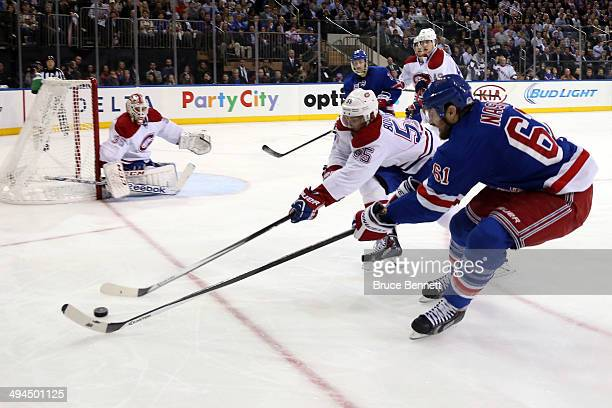 Rick Nash of the New York Rangers and Francis Bouillon of the Montreal Canadiens battle for the puck during Game Six of the Eastern Conference Final...