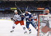 Rick Nash of the New York Rangers and Thomas Vanek of the New York Islanders vie for position in front of the Rangers net in the first period during...
