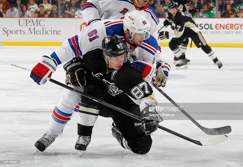 <a gi-track='captionPersonalityLinkClicked' href=/galleries/search?phrase=Rick+Nash&family=editorial&specificpeople=202196 ng-click='$event.stopPropagation()'>Rick Nash</a> #61 of the New York Rangers battles for the loose puck against <a gi-track='captionPersonalityLinkClicked' href=/galleries/search?phrase=Sidney+Crosby&family=editorial&specificpeople=212781 ng-click='$event.stopPropagation()'>Sidney Crosby</a> #87 of the Pittsburgh Penguins on February 7, 2014 at Consol Energy Center in Pittsburgh, Pennsylvania.
