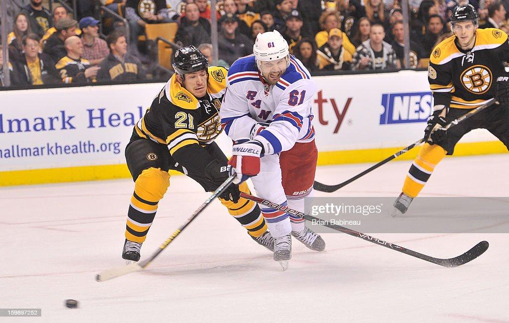 Rick Nash #61 of the New York Rangers battles for the puck against Andrew Ference #21 of the Boston Bruins at the TD Garden on January 19, 2013 in Boston, Massachusetts.