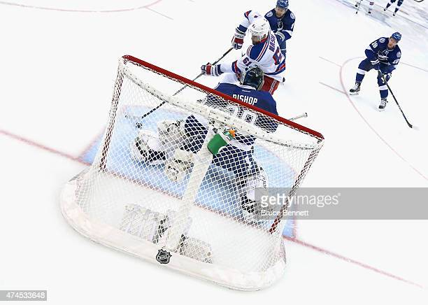 Rick Nash of the New York Rangers carries the puck in on Ben Bishop of the Tampa Bay Lightning in Game Four of the Eastern Conference Finals during...