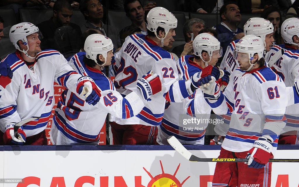 <a gi-track='captionPersonalityLinkClicked' href=/galleries/search?phrase=Rick+Nash&family=editorial&specificpeople=202196 ng-click='$event.stopPropagation()'>Rick Nash</a> #62 of the New York Rangers celebrates a third period goal with teammates during NHL game action against the Toronto Maple Leafs April 8, 2013 at the Air Canada Centre in Toronto, Ontario, Canada.