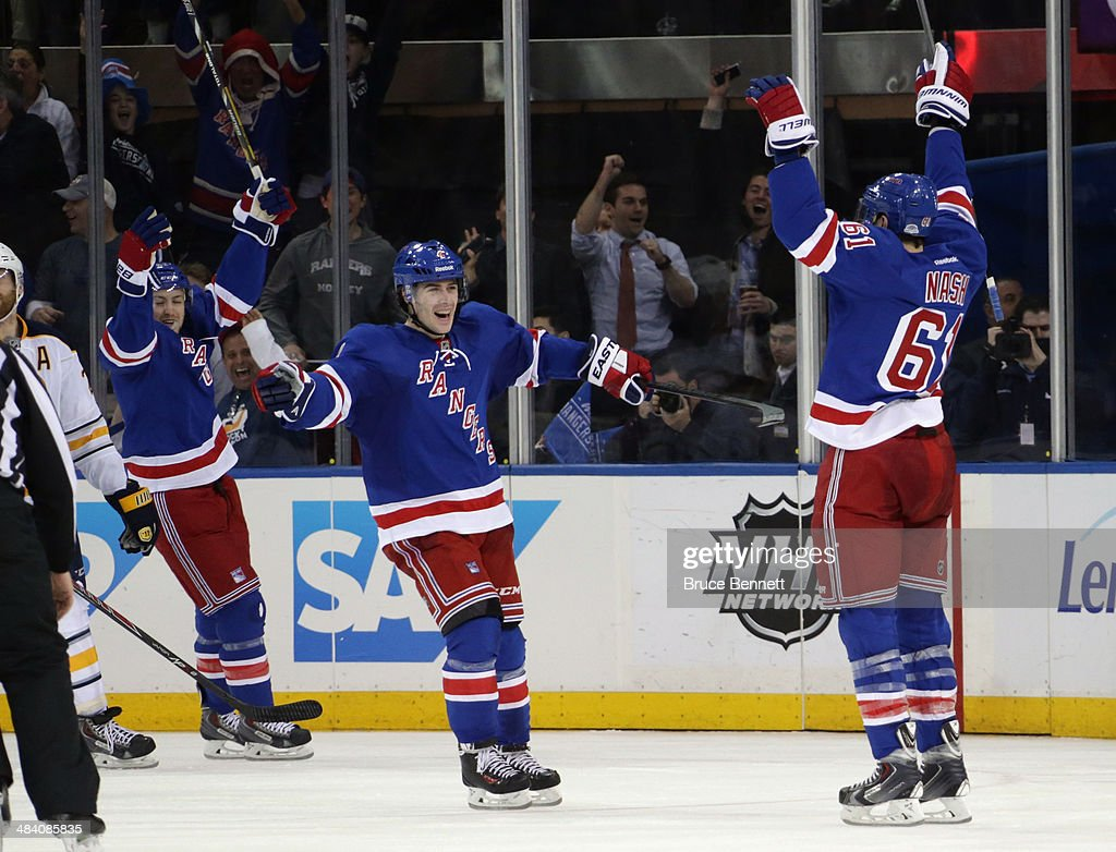 Rick Nash #61 of the New York Rangers (R) celebrates his game winning goal at 18:18 of the third period along with Raphael Diaz #4 (L) against the Buffalo Sabres at Madison Square Garden on April 10, 2014 in New York City. The Rangers defeated the Sabres 2-1.