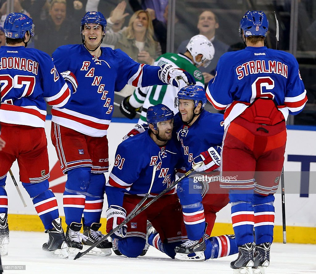 Rick Nash of the New York Rangers celebrates his game winning goal with teammates Chris Kreider and Derek Stepan in the third period against the...
