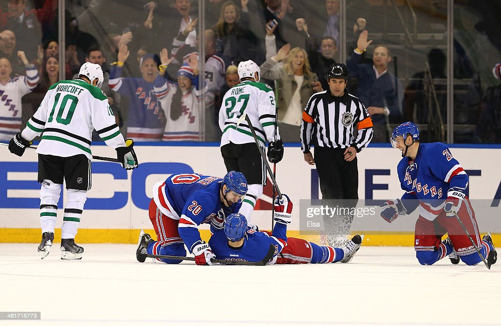 Rick Nash of the New York Rangers celebrates his game winning goal with teammates Chris Kreider and Derek Stepan in the third period as Shawn Horcoff...