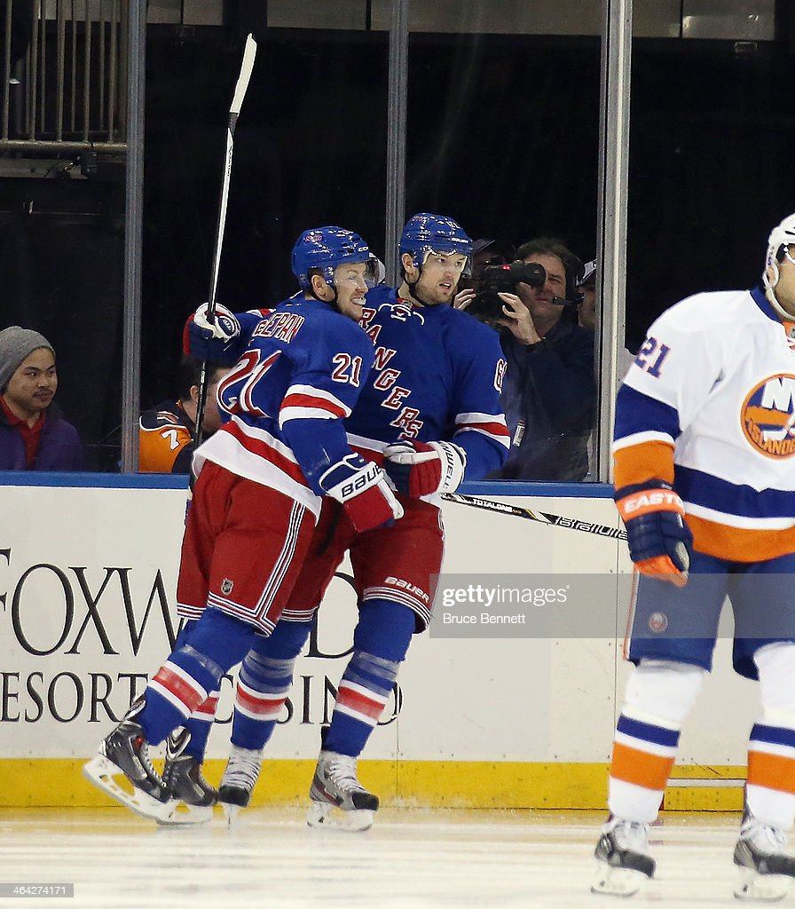<a gi-track='captionPersonalityLinkClicked' href=/galleries/search?phrase=Rick+Nash&family=editorial&specificpeople=202196 ng-click='$event.stopPropagation()'>Rick Nash</a> #61 of the New York Rangers celebrates his goal at 1:02 of the first period against the New York Islanders along with <a gi-track='captionPersonalityLinkClicked' href=/galleries/search?phrase=Derek+Stepan&family=editorial&specificpeople=4687181 ng-click='$event.stopPropagation()'>Derek Stepan</a> #21 (L) at Madison Square Garden on January 21, 2014 in New York City. The Islanders defeated the Rangers 5-3.