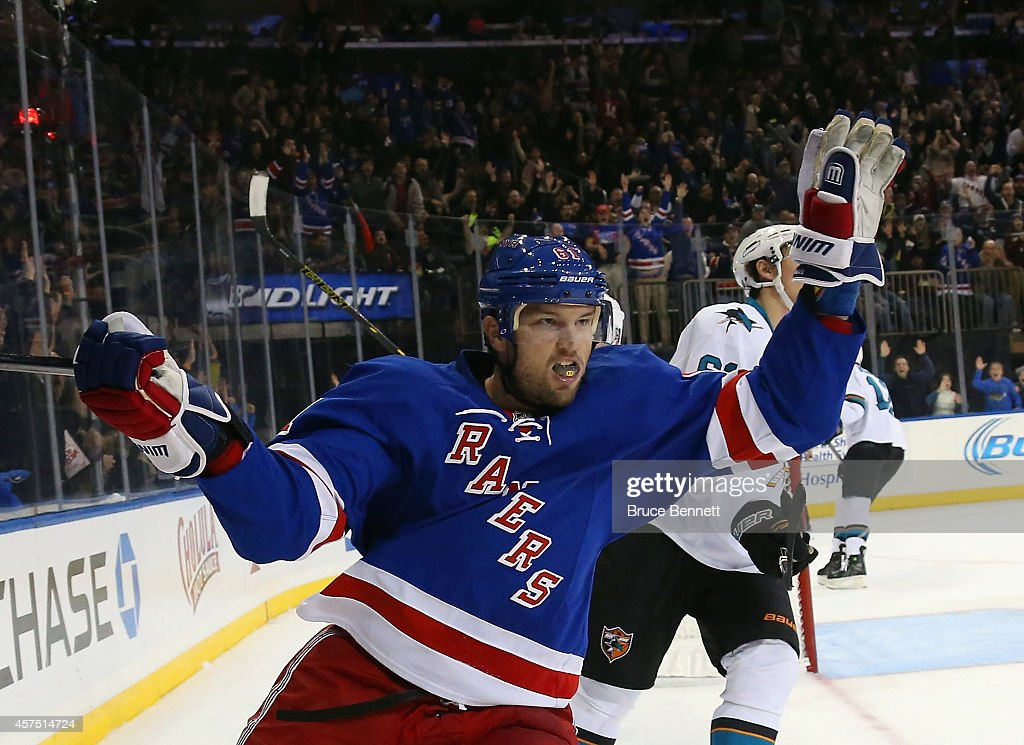 <a gi-track='captionPersonalityLinkClicked' href=/galleries/search?phrase=Rick+Nash&family=editorial&specificpeople=202196 ng-click='$event.stopPropagation()'>Rick Nash</a> #61 of the New York Rangers celebrates his goal at 19:20 of the second period against the San Jose Sharks at Madison Square Garden on October 19, 2014 in New York City.