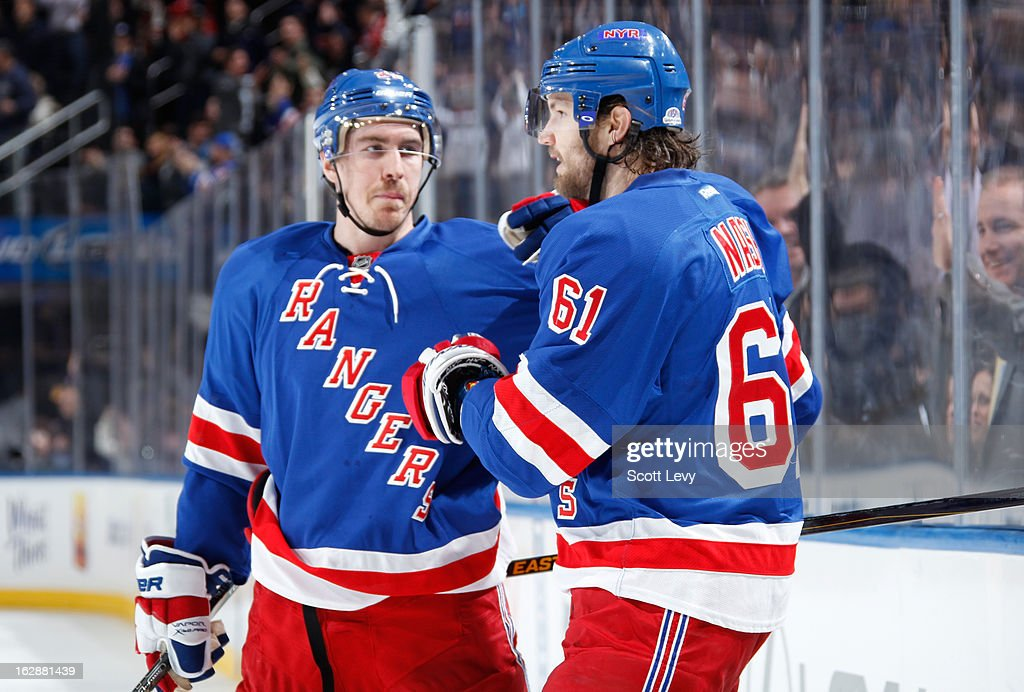 <a gi-track='captionPersonalityLinkClicked' href=/galleries/search?phrase=Rick+Nash&family=editorial&specificpeople=202196 ng-click='$event.stopPropagation()'>Rick Nash</a> #61 of the New York Rangers celebrates his goal in the third period against the Tampa Bay Lightning at Madison Square Garden on February 28, 2013 in New York City. The Rangers defeat the Lightning 4-1.