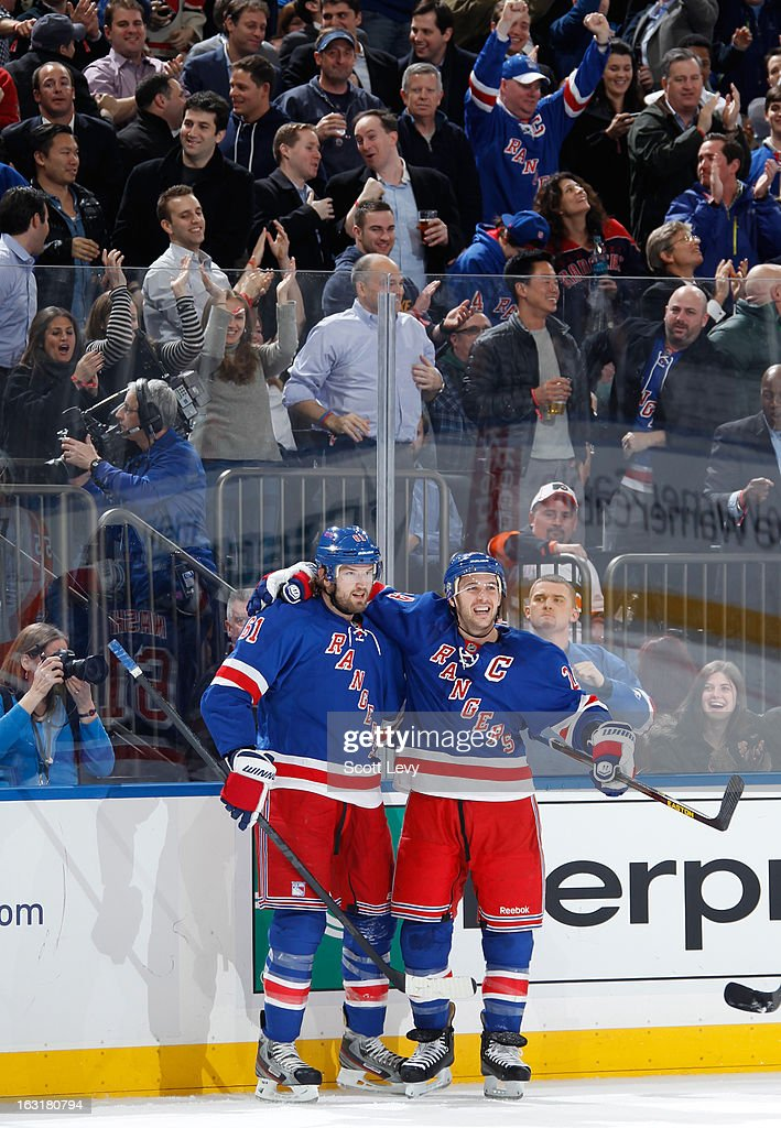 <a gi-track='captionPersonalityLinkClicked' href=/galleries/search?phrase=Rick+Nash&family=editorial&specificpeople=202196 ng-click='$event.stopPropagation()'>Rick Nash</a> #61 of the New York Rangers celebrates his goal with teammate <a gi-track='captionPersonalityLinkClicked' href=/galleries/search?phrase=Ryan+Callahan&family=editorial&specificpeople=809690 ng-click='$event.stopPropagation()'>Ryan Callahan</a> #24 against the Philadelphia Flyers at Madison Square Garden on March 5, 2013 in New York City. The Rangers defeat the Flyers 4-2.