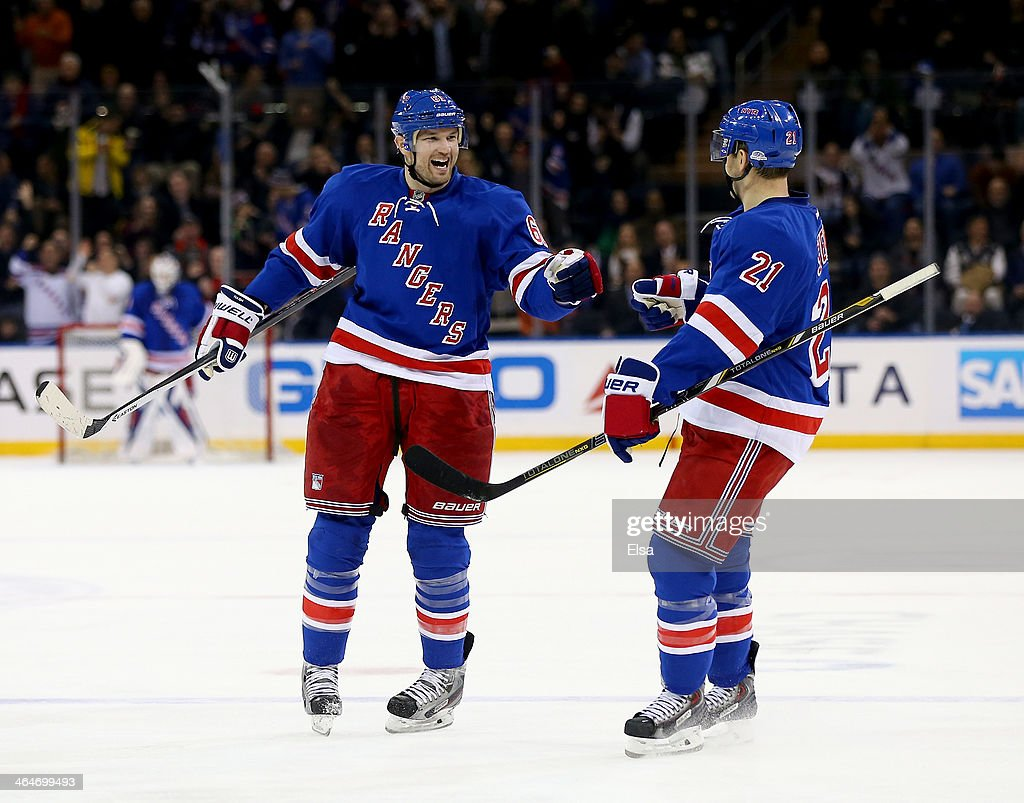 Rick Nash of the New York Rangers celebrates his goal with teammates Derek Stepan after Nash scored in the second period against the St Louis Blues...