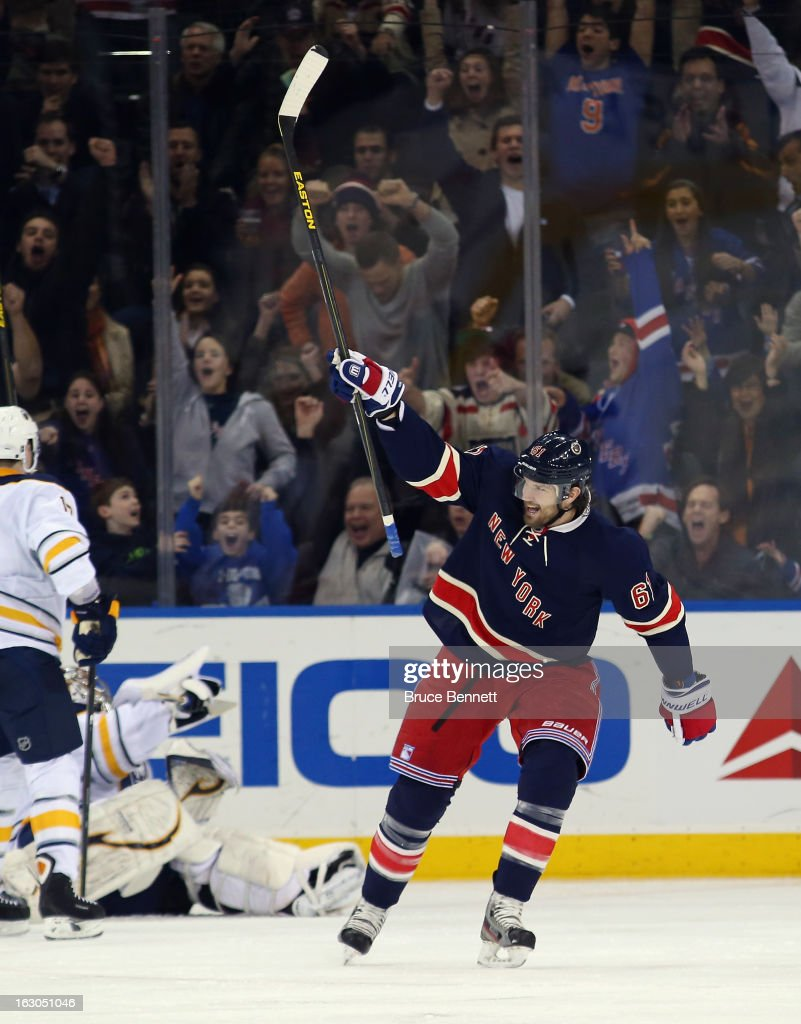 <a gi-track='captionPersonalityLinkClicked' href=/galleries/search?phrase=Rick+Nash&family=editorial&specificpeople=202196 ng-click='$event.stopPropagation()'>Rick Nash</a> #61 of the New York Rangers celebrates his powerplay goal 4:18 of the third period against the Buffalo Sabres at Madison Square Garden on March 3, 2013 in New York City. The Rangers defeated the Sabres 3-2 in the shootout.