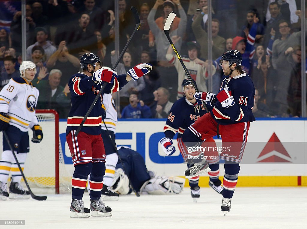 <a gi-track='captionPersonalityLinkClicked' href=/galleries/search?phrase=Rick+Nash&family=editorial&specificpeople=202196 ng-click='$event.stopPropagation()'>Rick Nash</a> #61 of the New York Rangers (R) celebrates his powerplay goal 4:18 of the third period against the Buffalo Sabres and is joined by <a gi-track='captionPersonalityLinkClicked' href=/galleries/search?phrase=Marian+Gaborik&family=editorial&specificpeople=202477 ng-click='$event.stopPropagation()'>Marian Gaborik</a> #10 (L) at Madison Square Garden on March 3, 2013 in New York City. The Rangers defeated the Sabres 3-2 in the shootout.