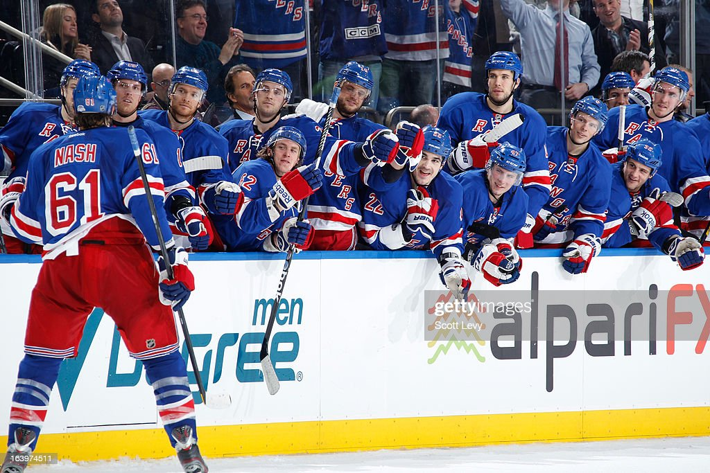Rick Nash #61 of the New York Rangers celebrates his shootout goal against the Carolina Hurricanes at Madison Square Garden on March 18, 2013 in New York City.
