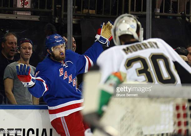 Rick Nash of the New York Rangers celebrates his shorthanded goal at 39 seconds of the second period against Matt Murray of the Pittsburgh Penguins...