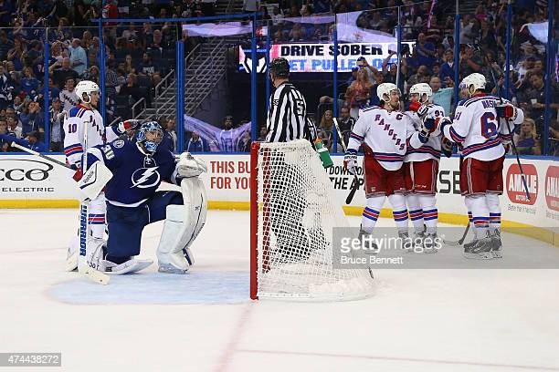 Rick Nash of the New York Rangers celebrates with his teammates after scoring a goal against Ben Bishop of the Tampa Bay Lightning during the third...