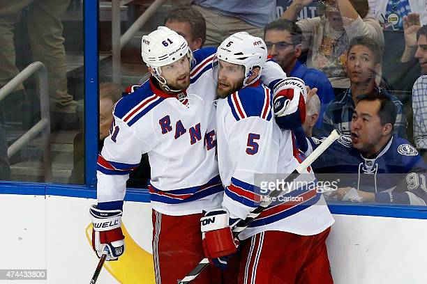 Rick Nash of the New York Rangers celebrates with teammate Dan Girardi after scoring a goal during the first period against Ben Bishop of the Tampa...