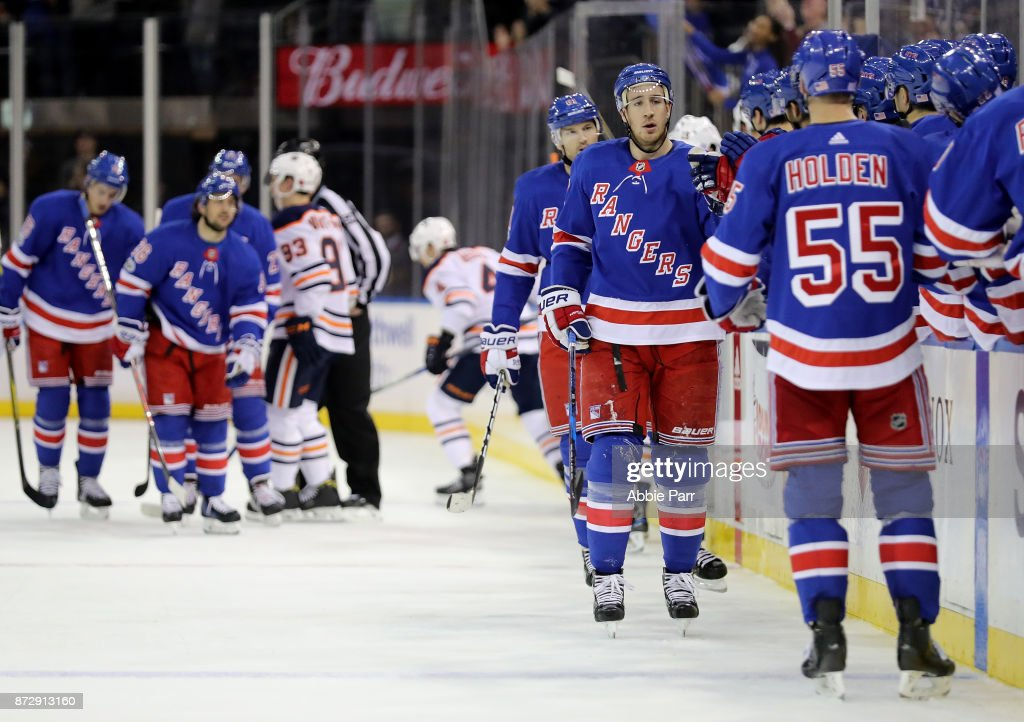 Rick Nash #61 of the New York Rangers celebrates with teammates after scoring a goal against the Edmonton Oilers in the first period during their game at Madison Square Garden on November 11, 2017 in New York City.
