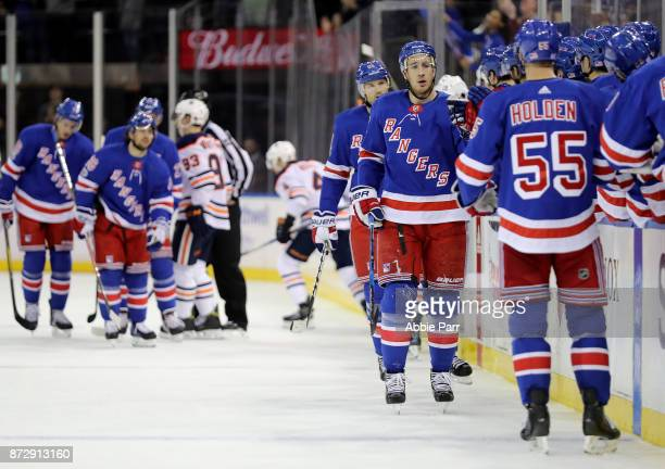 Rick Nash of the New York Rangers celebrates with teammates after scoring a goal against the Edmonton Oilers in the first period during their game at...