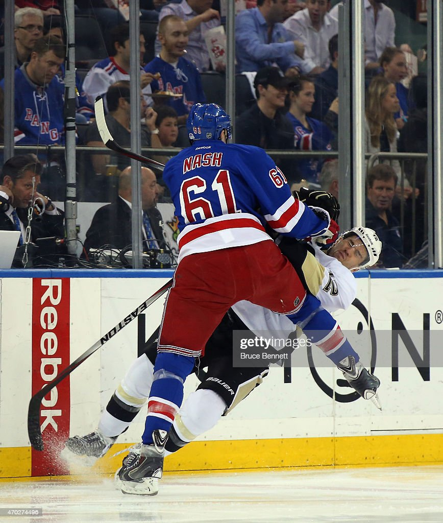 <a gi-track='captionPersonalityLinkClicked' href=/galleries/search?phrase=Rick+Nash&family=editorial&specificpeople=202196 ng-click='$event.stopPropagation()'>Rick Nash</a> #61 of the New York Rangers checks <a gi-track='captionPersonalityLinkClicked' href=/galleries/search?phrase=Ben+Lovejoy&family=editorial&specificpeople=4509565 ng-click='$event.stopPropagation()'>Ben Lovejoy</a> #12 of the Pittsburgh Penguins during the first period in Game One of the Eastern Conference Quarterfinals during the 2015 NHL Stanley Cup Playoffs at Madison Square Garden on April 18, 2015 in New York City.