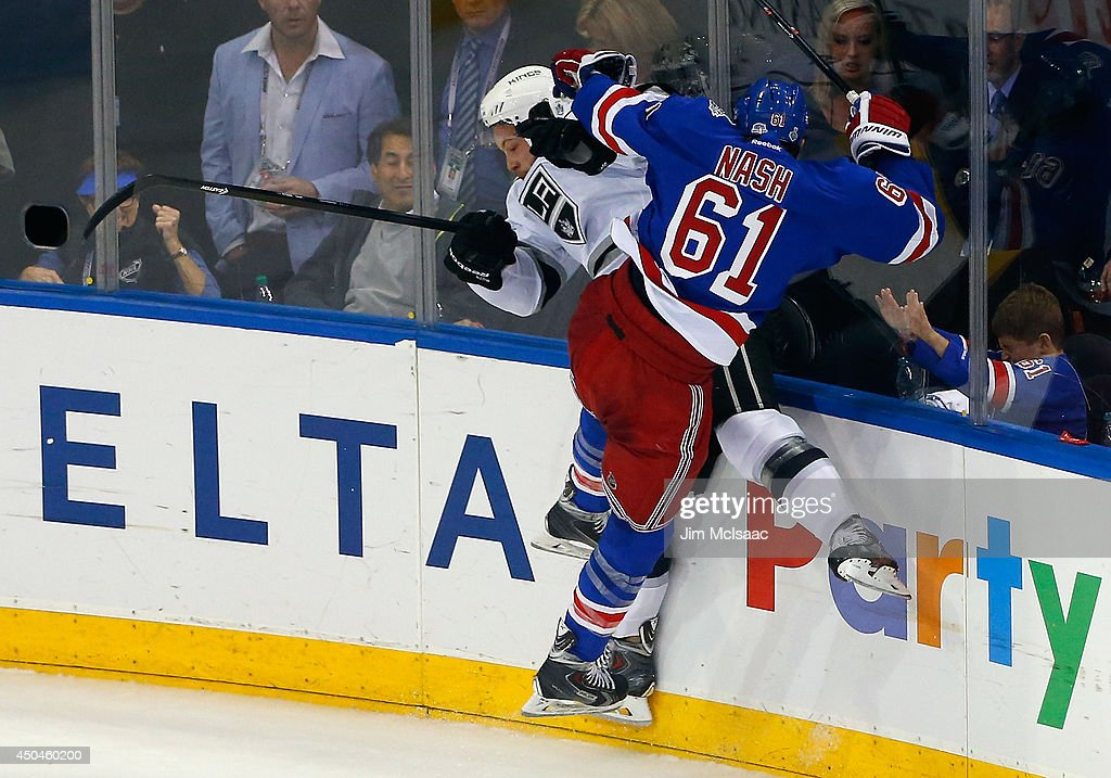 Rick Nash #61 of the New York Rangers checks Jake Muzzin #6 of the Los Angeles Kings during the second period of Game Four of the 2014 NHL Stanley Cup Final at Madison Square Garden on June 11, 2014 in New York, New York.