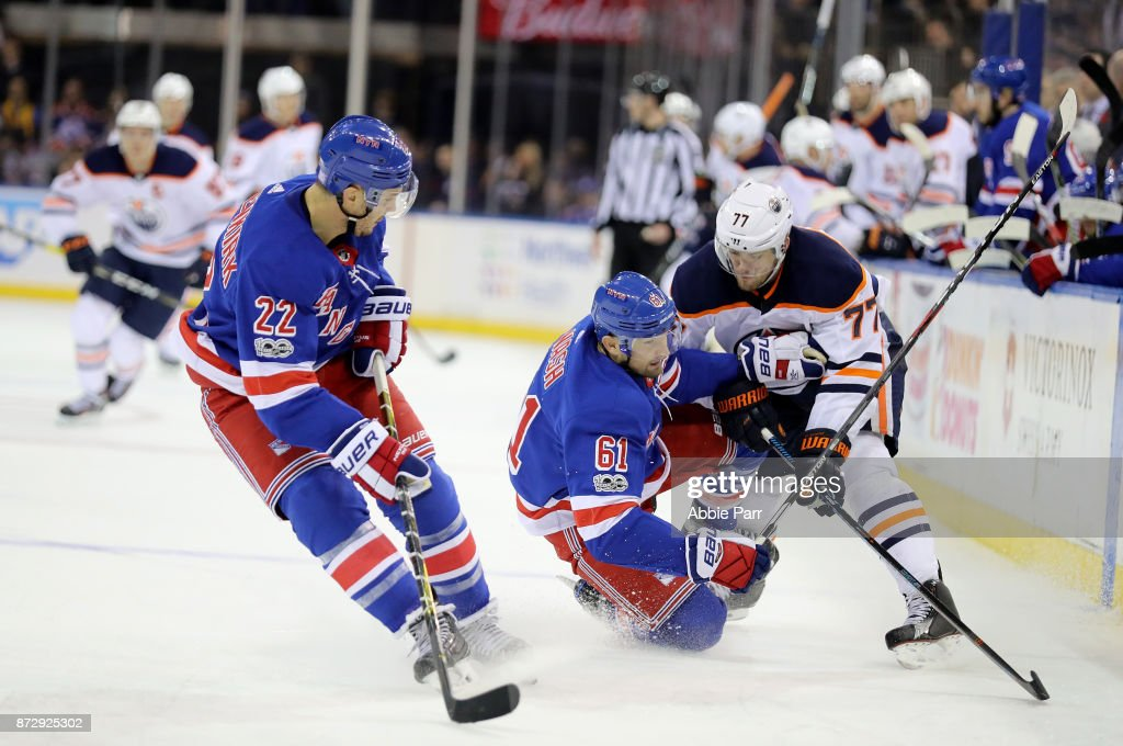Rick Nash #61 of the New York Rangers collides with Oscar Klefbom #77 of the Edmonton Oilers in the third period during their game at Madison Square Garden on November 11, 2017 in New York City.