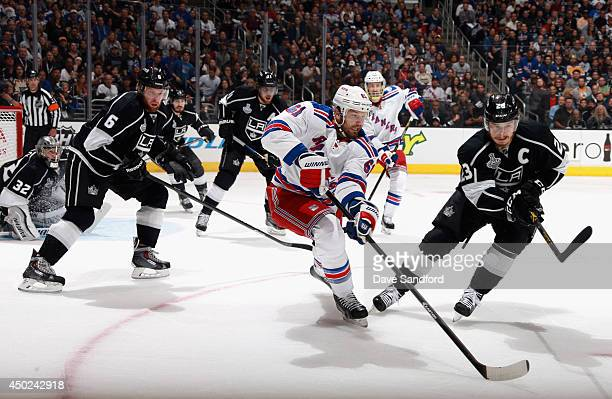 Rick Nash of the New York Rangers controls the puck away from Dustin Brown of the Los Angeles Kings in the first period of Game Two of the 2014...